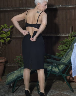 Horny British mature Fleur stripping in her garden