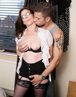 Naughty British mom fooling around with her toy boy