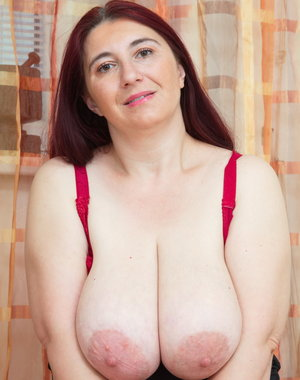 Huge breasted mama playing around