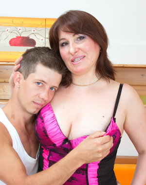 Naughty big breasted housewife fucking her toy boy