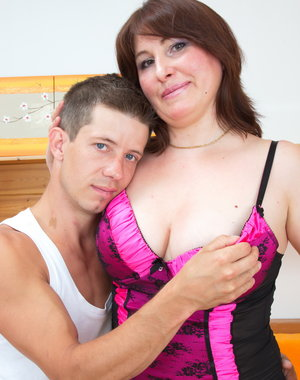 Hot housewife playing with her toy boy