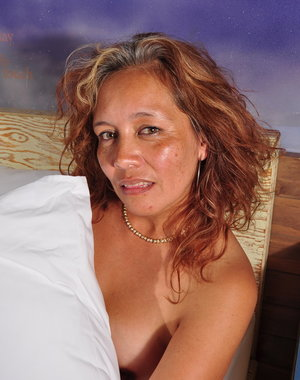 Naughty Latin housewife playing on her bed