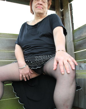 Naughty German BBW posing in a field