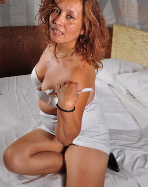 Horny Latin Housewife getting frisky on her bed
