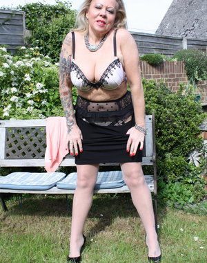 Naughty British housewife stripping in the garden