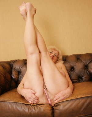 Horny granny gets wet on her couch