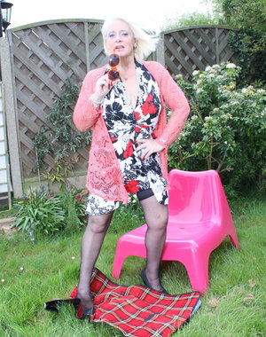 Horny mature lady playing in the garden