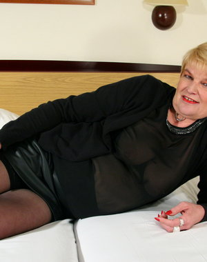 Naughty Dutch housewife playing on her bed