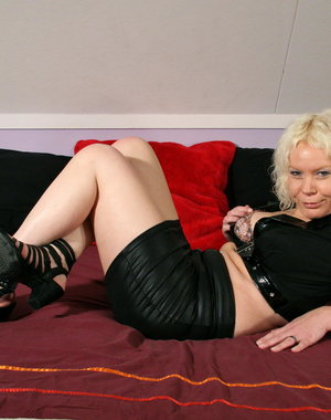 Blonde Dutch housewife teasing on her bed