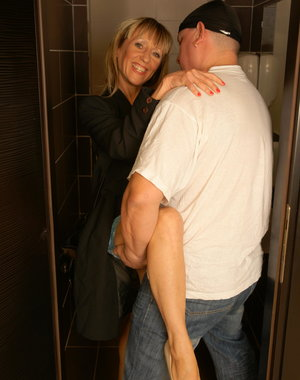 Horny mature slut fucking on a toilet