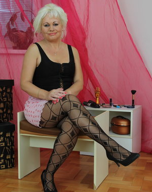 Blonde mature slut getting ready to party on her own