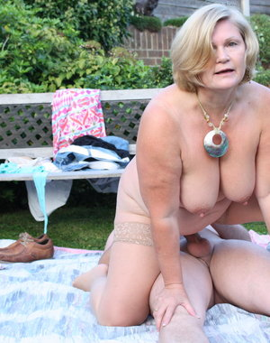 Naughty mature slut fucking her toy boy in the garden