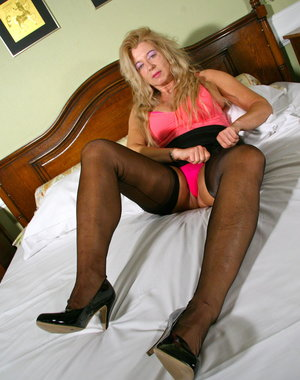 Naughty blonde mature slut pleasing and teasing