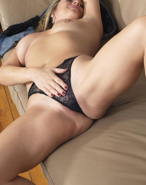 Horny housewife playing alone on her couch