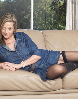 Naughty British housewife getting frisky on the couch