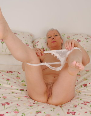Horny mature slut stripping and teasing