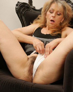 Hairy housewife masturbating in her chair
