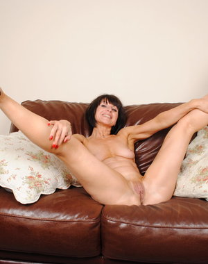 Naughty MILF playing on her couch