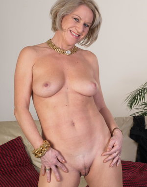 Naughty housewife getting naked and naughty