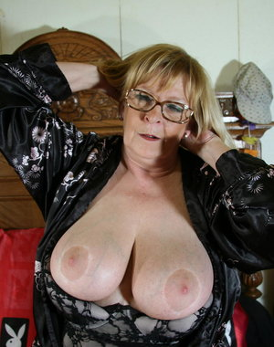 This big breasted mama is getting wet