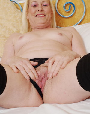 Blonde mature slut getting naked and wicked