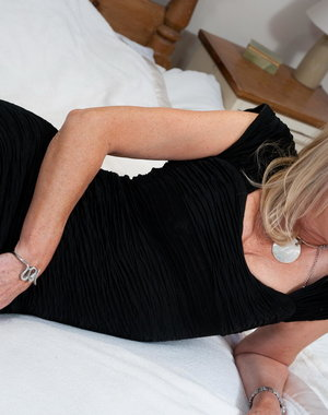 Hot housewife playing alone on her bed