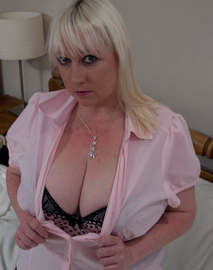 blonde mature slut playing with her huge boobs