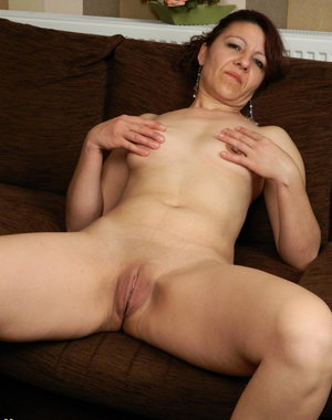 Horny mature slut getting wet on her couch