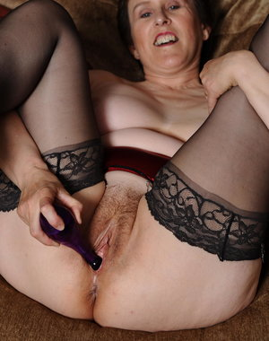 Horny mature slut playing with a dildo