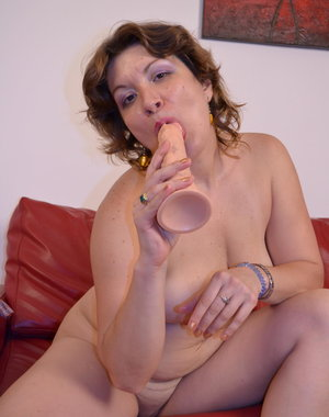 This naughty mama loves a good long dildo