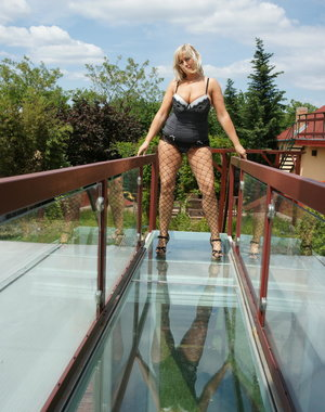 Naughty blonde housewife playing outside the house