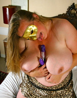 Big breasted masked mature slut playing with herself
