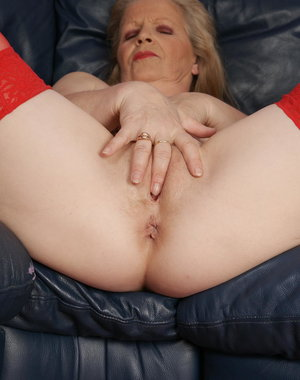 Blonde mature slut playing all alone on her couch