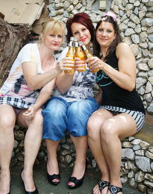Three old and young lesbians have outdoor fun