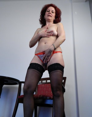 This red mature slut loves to go wild on her own