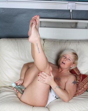 Horny blonde housewife playing alone