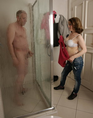 Old dude caught by a hot babe in the shower