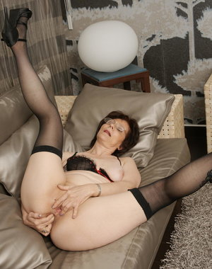 Naughty housewife playing on the couch