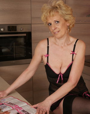 Blonde mature slut playing in the kitchen