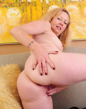 Horny mama playing on the couch