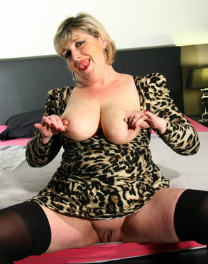 Big breasted mature slut loves to play alone