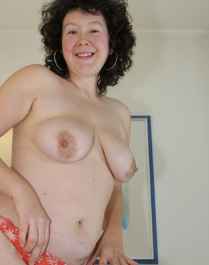 Horny mature slut getting naked and frisky