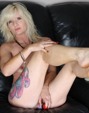 Blonde mom getting her pussy wet