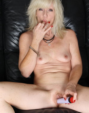Blonde mom masturbating on the couch
