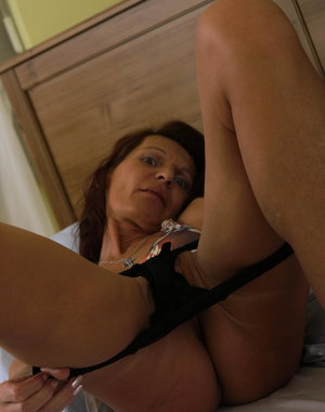 Naughty housewife enjoying her special toy