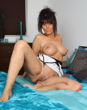 Playfull MILF gets naked and wicked