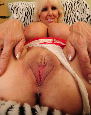 Blonde mature slut with huge boobs masturbating