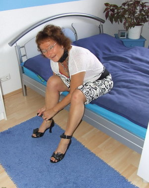 Kinky housewife Gabriele tied up on her bed