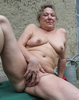 This mature slut loves weeding in the garden