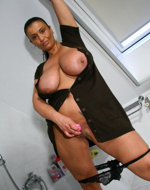Big breasted MILF playing around the house
